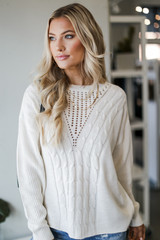 Ivory - Model wearing a Cable Knit Sweater with jeans