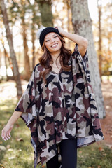 Model wearing an Oversized Brushed Knit Camo Poncho