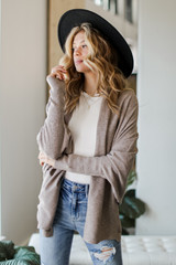 Taupe - Model wearing a Soft Knit Cardigan with a wide brim hat