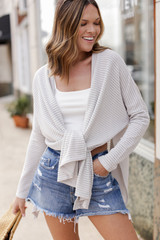 Grey - Dress Up Model wearing a Loose Knit Cardigan with denim shorts