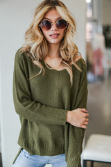 Olive - Model wearing an Oversized Knit Sweater with jeans