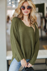 Olive - Dress Up model wearing an Oversized Knit Sweater with jeans