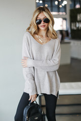 Taupe - Model wearing an Oversized Knit Sweater with leggings