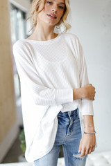 White - Model wearing an Oversized Waffle Knit Top with jeans