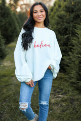Model wearing the Believe Oversized Pullover