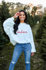 Dress Up Model wearing the Believe Oversized Pullover