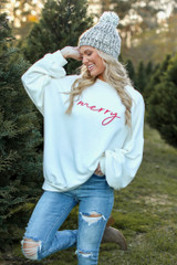 Model wearing the Be Merry Oversized Pullover