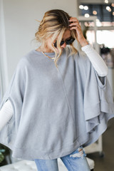 Heather Grey - Model wearing a Brushed Knit Poncho