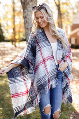 Model wearing a Plaid Fringe Shawl