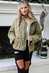 Model wearing an olive Quilted Knit Jacket