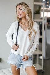 Dress Up model wearing the Charleston Distressed Sweater