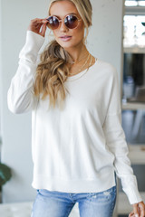 Ivory - Model wearing a Soft Knit Sweater with sunglasses