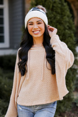 Taupe - Model wearing a Fuzzy Knit Hoodie with a beanie