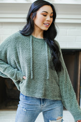 Olive - Model wearing a Fuzzy Knit Hoodie with jeans
