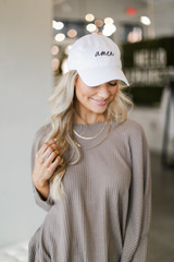 Front View of the Amen Cap in White