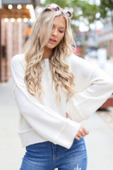 Ivory - Dress Up model wearing an Oversized Cropped Sweater with jeans