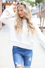 Ivory - Model wearing an Oversized Cropped Sweater with jeans