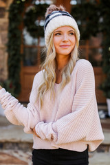 Blush - Model wearing an Oversized Chenille Sweater with a beanie