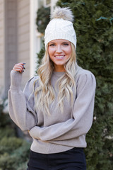 Mocha - Model wearing a Puff Sleeve Sweater with a beanie