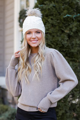 Mocha - Dress Up model wearing a Puff Sleeve Sweater with a beanie