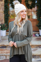 Olive - Model wearing a Ribbed Knit Babydoll Top with a beanie