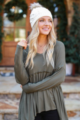 Olive - Dress Up model wearing a Ribbed Knit Babydoll Top with a beanie