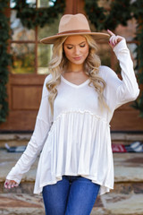 White - Dress Up model wearing a Ribbed Knit Babydoll Top with jeans