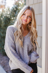 Heather Grey - Model wearing a Fuzzy Knit Sweater with black jeans