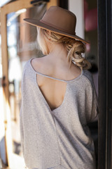 Model wearing an Oversized Glitter Knit Top in Taupe Back View