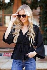 Surplice Peplum Blouse in Black Front View
