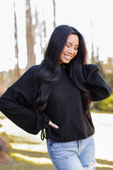 Black - Dress Up model wearing a Mock Neck Waffle Knit Top with jeans