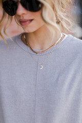 Model wearing a Gold Star + Moon Layered Necklace