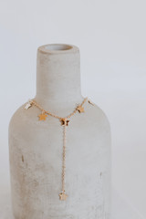 Flat Lay of a Gold Star Drop Chain Necklace
