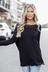 Black - Model wearing an Oversized Jersey Knit Top with jeans
