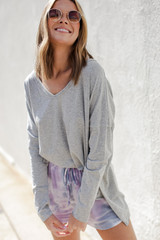 Heather Grey - Model wearing a Basic Oversized Knit Top with denim shorts