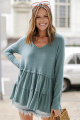 Sage - Model wearing a Brushed Knit Tiered Babydoll Top with sunglasses