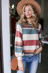 Model wearing an Oversized Striped Pullover