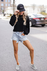 Model wearing a Ribbed Knit Crop Top with denim shorts