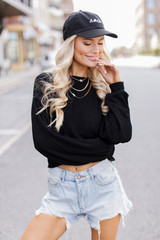 Model wearing a Ribbed Knit Crop Top with a baseball cap
