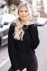 Model wearing a Ribbed Knit Crop Top with black leggings