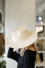 Side and top view of ivory wide brim hat