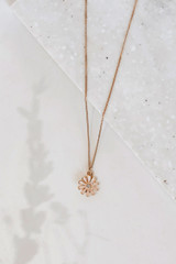 Flat Lay of a Gold Flower Necklace