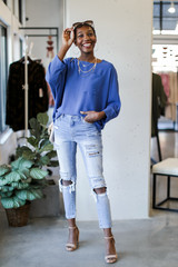 Model wearing an Oversized Front Pocket Blouse in Denim with skinny jeans