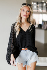 Model wearing a black Swiss Dot Blouse