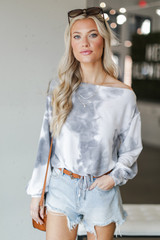 Model wearing a Tie-Dye Cropped Pullover with denim shorts