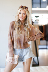Model wearing a Tie-Dye Waffle Knit Top in Brown with denim shorts