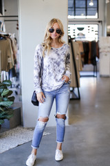 Model wearing an Oversized Tie-Dye Pullover with jeans