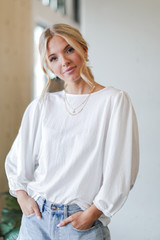 Model wearing a Puff Sleeve Blouse in White