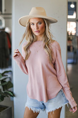 Blush - Model wearing a Light Knit Pullover with a wide brim hat