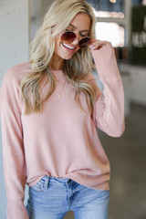 Blush - Dress Up model wearing a Loose Fit Sweater with jeans